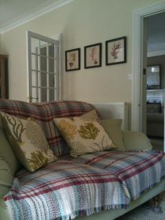 Sitting room - seating for 10 on comfy sofas and armchairs, with games table, TV and DVD player