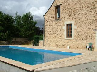The pool is to the rear of the house, a suntrap during the day and lit by the stars at night