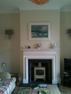 Sitting room - a lovely, large, sunny room with wood burning stove and sea view