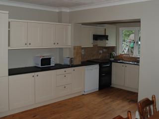Kitchen with dishwasher, full size fridge freezer, washer/dryer etc