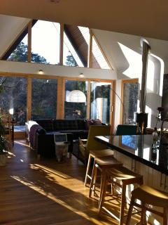 kitchen lounge area over looking the forest and river