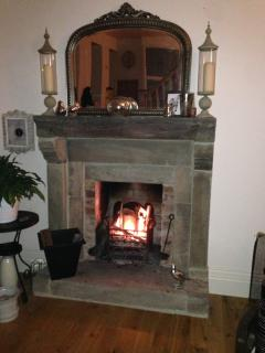 After a tiring day put your feet up by the fire with a glass of red