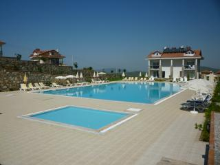 The child friendly pool with the large swimming pool in the background.