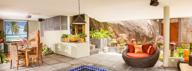 Tropical style living area imaginatively created around ancient granite boulders