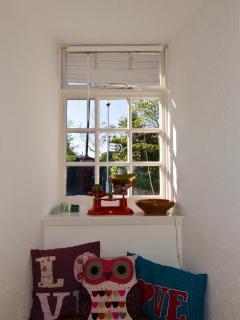 Kitchen's original window set deeply into centuries-old walls
