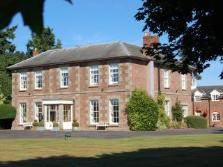 Wharton Lodge with cottage courtyard behind. Luxury accommodation for couples and small groups.