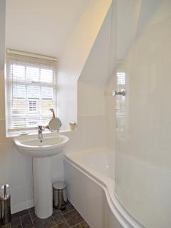 Bathroom window lets in lots of light to give the Bathroom a bright atmosphere