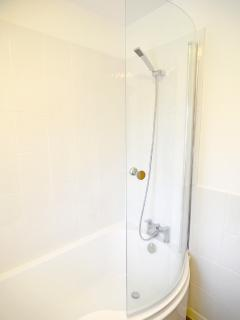 Combined power shower and bath is one of the many modern touches in this old cottage