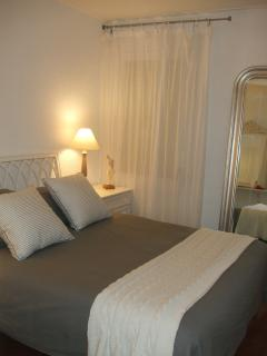 Bed 1 with King sized bed, fitted wardrobes, bedside chests, lamps, elegant ornate mirrors