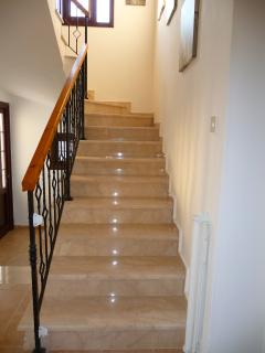 Marble staircase with child-safety gate