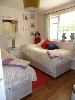Front childrens bedroom with ample toys, books, games and beach toys