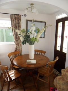 Dining area which is an intergral part of the main lounge and back door to rear garden/decking area
