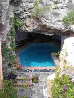 solarheated Jacuzzi Pool set into cave