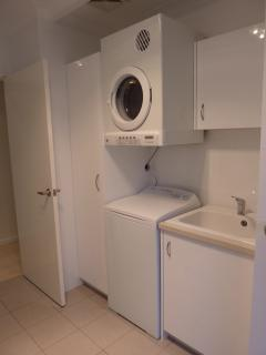 Brand new laundry - fully equipped with machine, dryer and iron
