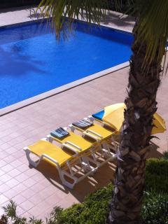 Sun beds for use by poolside.