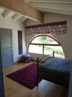 Upstairs bedroom overlooking the lane up to the vineyards and oak forest.  Shower and dressing room.