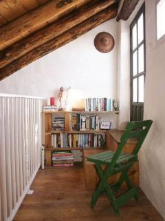 Mezzanine above sitting room houses lots of good books, CDs and DVDs and leads out to the terrace