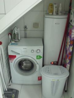 Utility room with washer/dryer, iron etc.
