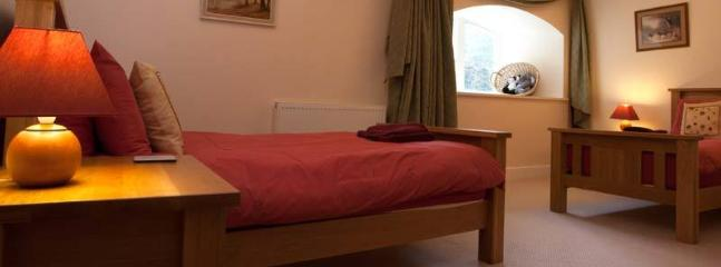 Spacious twin bedded room with 2 single beds