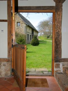 View to The Barn from the stable door into central courtyard, lovely to have open in the summer