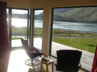 The lounge in Larchwood with views to Skye and up Loch Long also