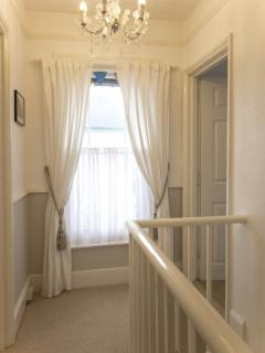 Upstairs at the Albury Cottage with sea glimpses