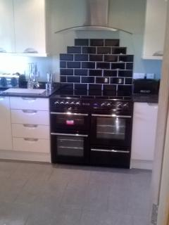 Fully equipped kitchen with large range cooker