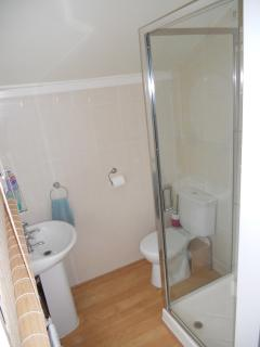 There are 2 shower rooms with toilets and wash basins on the same floor as the bedrooms.
