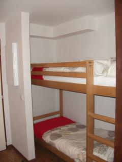 Cabin bunks. There is quite a big space at the side of the bunks and a cupboard on the opposite wall