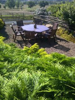 Front and back sunny gardens with tables and seating for alfresco dinning