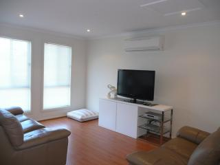TV area with large TV and comfy Lounge Suites