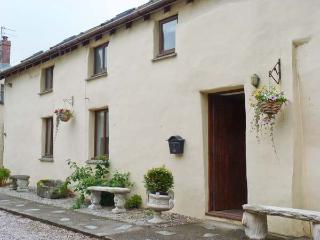 NO. 2 THE OLD COACH HOUSE, pet-friendly cottage by village pub, close to coast