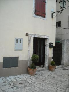 Closed to the house, ( the brown door to the left) there is a small courtyard with a BBQ area