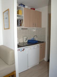 Kitchen area with full size Fridge and Dishwasher