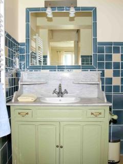Master bedroom en suite bathroom, antique vanity unit with marble top