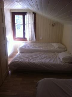 third bed in bedroom