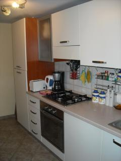 A well equipped kitchen situated on the groundfloor