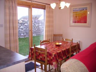 Dining room can seat up to 8 people comfortably with patio doors leading onto enclosed garden.