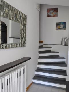 particular villa interior - staircase leading to the rooms