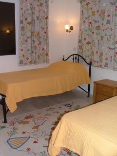 TWIN BEDROOM( smaller bright and cheerful with  folding cot available,mountain views