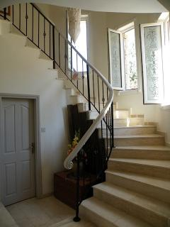 HALL spacious, well ventilated and with cloakroom  under the stairs.