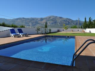 The 9m x 3m pool, terrace and views of the mountains