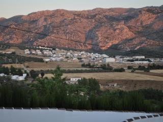 The sunset from the house and views to the village of Rossario