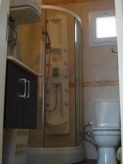 and a power shower, in the bathroom.