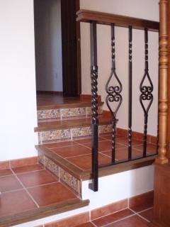 Spanish Terrocotta floor. Steps leading down into Bedroom 2.
