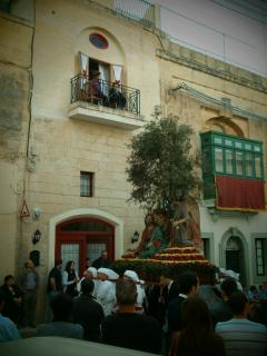 The facade of the House with the statue on Good Friday procession