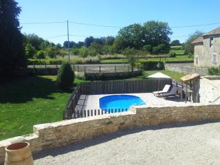 A good view of the Pool, with its decking surround, from the extensive rear patio area.