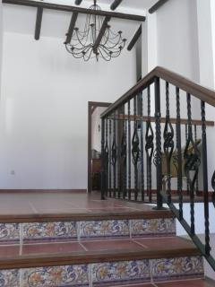 Wide terracotta tiled staircase leading to bedrooms.