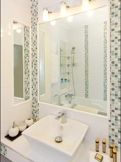 Main bathroom with bath, shower fitting and toilet