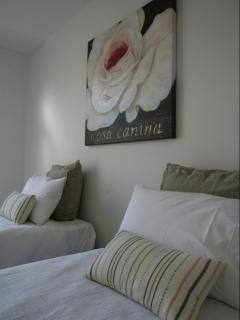 We welcome families with our second bedroom accommodating two king single beds upon request.